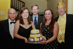 The London Legal Support Team draft in help to cut their 10th Anniversary birthday cake. (From left: Judge Rinder, Natalia Rymaszewska, Dominic Grieve QC MP, Vicky Naylor, Bob Nightingale).