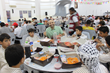 Amer Abdallah hosts a dinner for the families in AlBaqaa Refugee Camp.