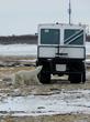 Polar bear checks out a Tundra Buggy