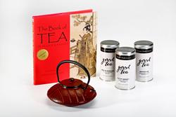 Loose teas, teapot and book