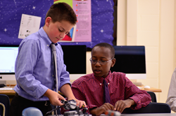 Hun Middle School students Griffin Mumme '20 and Gibson Campbell '21 worked together to make design adjustments to their convoy robots.