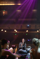 Salt Lake Community College dance instructor Tess Boone talks to dancers at Grand Theatre.