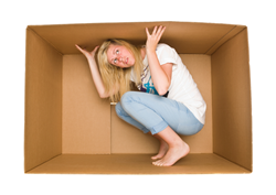 A woman in a cardboard box