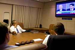 Aboard Air Force One, President Obama watches the Perception Analyzer data lines from CNN's coverage of the Vice Presidential Debate.