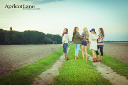Fall Lifestyle Image- Girls in field featuring Apricot Lane fashions, shoes and accessories