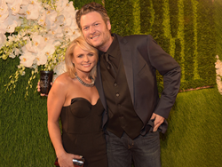Miranda Lambert carries the Jill Milan 450 Sutter Clutch to BMI 2014 Country Awards with husband Blake Shelton, November 4, 2014 in Nashville, Tennessee. (Photo by Rick Diamond/Getty Images for BMI)