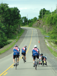 CanAm Veterans Challenge athletes ride bicycles along the highway on route to Washington, D.C.