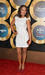 Laila Ali carries Jill Milan's Laurel Canyon clutch to 2014 Soul Train Music Awards, Nov. 7, 2014 in Las Vegas. (Photo: Earl Gibson/BET/Getty Images for BET)