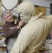 Chris Navarro working on clay orginal.Wyoming Cowboy sculpture