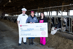 Andi Rynes, Hawk High Dairy, accepts drawing prize