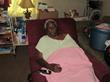 An Elderly Widow Receives Assistance from St. Johns Housing...