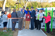Chattanooga Mayor Andy Berke and East Lake residents cut the ribbon at the East Lake Fitness Zone