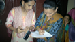 A community health worker registers a pregnant woman for the mMitra service, a partnership between MAMA and ARMMAN