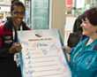 Papua New Guinea hurdler signs the Drug-Free Pledge at the 2014 Commonwealth Games.