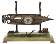 Lot 160: French industrial animated torpedo clock in a silvered, torpedo-shaped case with gilt brass trimmings, with compass and barometer (est. $20,000-$30,000).