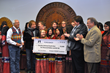 (L to R) Cherokee Nation Principal Chief Bill John Baker, Foreigner Bassist Jeff Pilson and Manager Phil Carson, and Deputy Chief S. Joe Crittenden congratulate the Cherokee National Youth Choir on winning $10,000 from the GRAMMY Foundation on Thursday, Nov. 13.