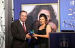 Nick Kaldas, APM, Deputy Commissioner of the NSW Police Force, receives Leading by Example Award from Coptic Orphans founder and Executive Director Nermien Riad in Lilyfield, NSW on Nov. 9, 2014