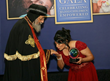 His Holiness Pope Tawadros II accepts the Leading by Example Award from Coptic Orphans founder and Executive Director Nermien Riad in Brampton, Canada, Sept. 28, 2014.