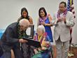 Sadako receives plaque from Hawaii House Speaker Joseph M. Souki