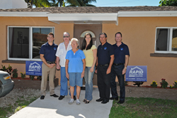 L to R: Jason Coben, Manager, Rapid Response Team; Roy and Barbara Gladde; Sandra Veszi-Einhorn, Executive Director, Rebuilding Together Broward; Charles Dixon, Director of Roofing Operations, RRT Roofing; Kevin Walton, COO, Rapid Response Team.