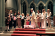 """Girl Scouts from Troop 57003 and Troop 50740 present The Rt. Rev. Dorsey McConnell, Bishop of the Episcopal Diocese of Pittsburgh with 100 """"Pray & Play"""" bags and explain their usage."""