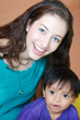 Zoe Mesnik-Greene with child in Peru after cleft lip surgery