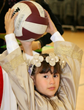 Saint Isabelle passes the ball back in one of the All Saints Day competitions.