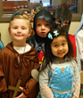 Three year old preschoolers at Everest Academy  dress the part and recognize the saint in one another.