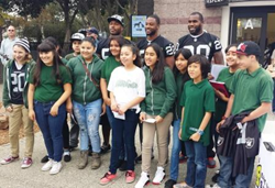 Oakland Raiders visit with TLC students at East Bay SPCA