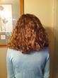 Photo of girl who woke up tangle-free after sleeping on Hair Fairy.