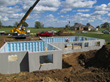 Installation of a precast concrete wall system from Superior Walls.