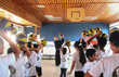 Fr. Quirico Calella, OFM, Director of the Terra Santa School in Acre, shows children how to correctly shoot a basketball.