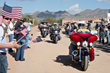 A motorcycle escort of U.S. veterans lead Sgt. Robert Bruce to his new home. More than 2,000 volunteer hours were donated by Taylor Morrison and its suppliers to help accomplish the task.