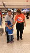 Miami Airports Tap The App team member assists with downloads