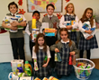 Everest Academy students helped to collect various personal items and household items for the guests who will be attending the Community Christmas Bash.