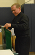 Fr. Jon Budke, LC, President of the Board of Directors at Everest Academy in Lemont, helps out and lends a hand with the wrapping.
