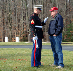 Stan Clark talks with an Honor Guard.
