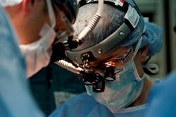 Surgeon operating.