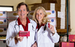 Dr. Bo Martinsen and Dr. Anne-Marie Chalmers holding the Omega Cure Extra Strength vials