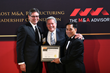 (L-R) Fred McCallister - SVP Allegiance Capital and Brent Earles - SVP, Allegiance Capital accept The M&A Deal of the Year award from Roger Aguinaldo, Founder/CEO M&A Advisor