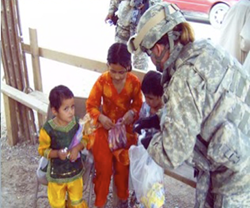 Troops share their supplies with local village children in Afghanistan.