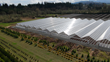 Aerial view of Conley's Gable Series 7500 Greenhouse Range recently installed at Fall Creek Farm & Nursery in Lowell, OR.  This photo shows phase 1 of 2 of a 7.3 acre sized project.