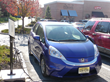 A Honda Fit EV gets a recharge at a SemaConnect ChargePro Charging Station while its driver spends time shopping at the Promenade