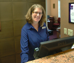 Kathy Kelly behind the desk at the Sleep Inn and Suites