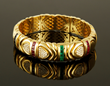 Bulgari 18K yellow gold, diamond, sapphire, ruby, and emerald bracelet