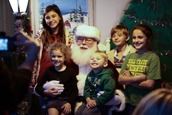 A photo of children posing with Santa