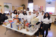 Aria Health President and CEO Kathleen Kinslow, CRNA, EdD, MBA, and Aria Health volunteers prepare 200 Thanksgiving meal baskets at the Lutheran Settlement House