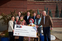 Gates Denver HQ Presents Check to Denver Chapter of the Ronald McDonald House