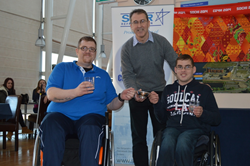 Star's Director of Sales Alan Walkinshaw with curling champions John Doyle and Daniel Cowan