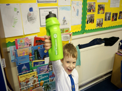 boy with waterbottle and personalised name label